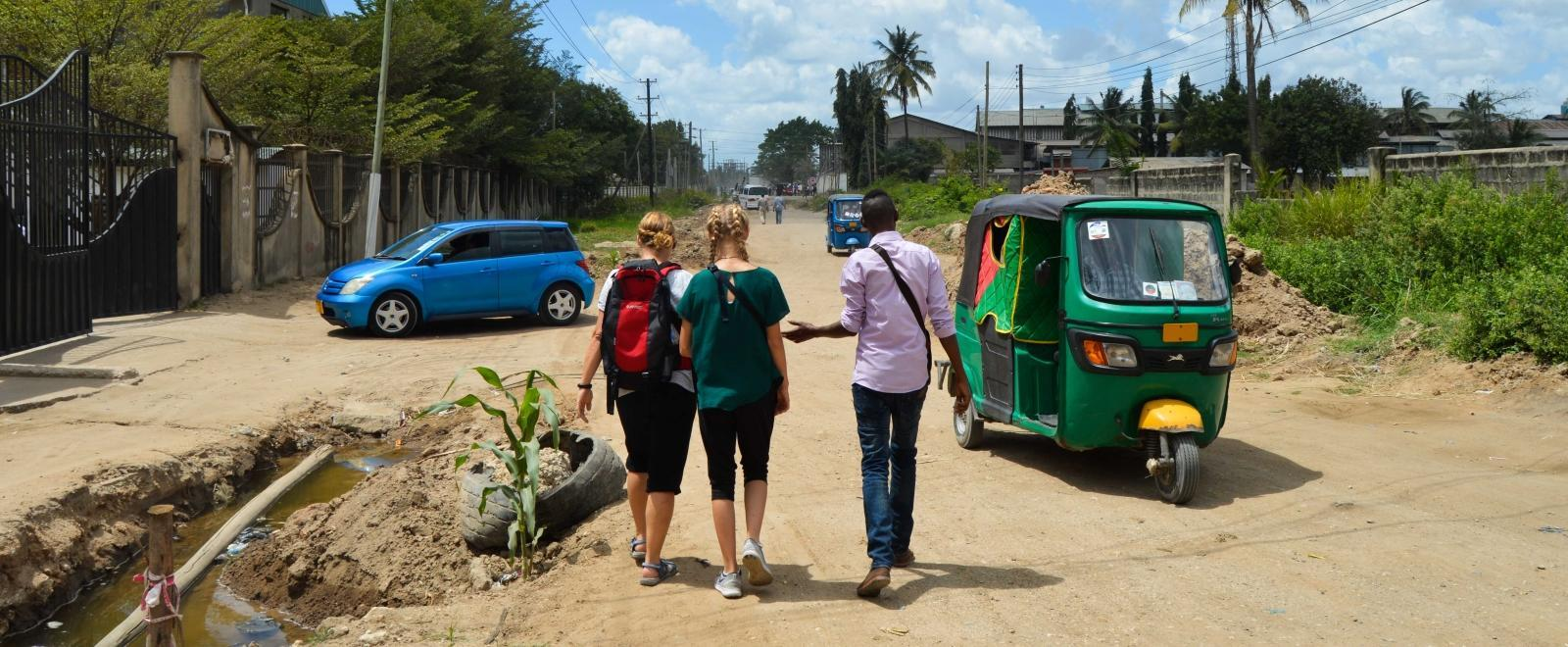 Volunteers follow a Projects Abroad staff member while learning how to navigate Tanzania.
